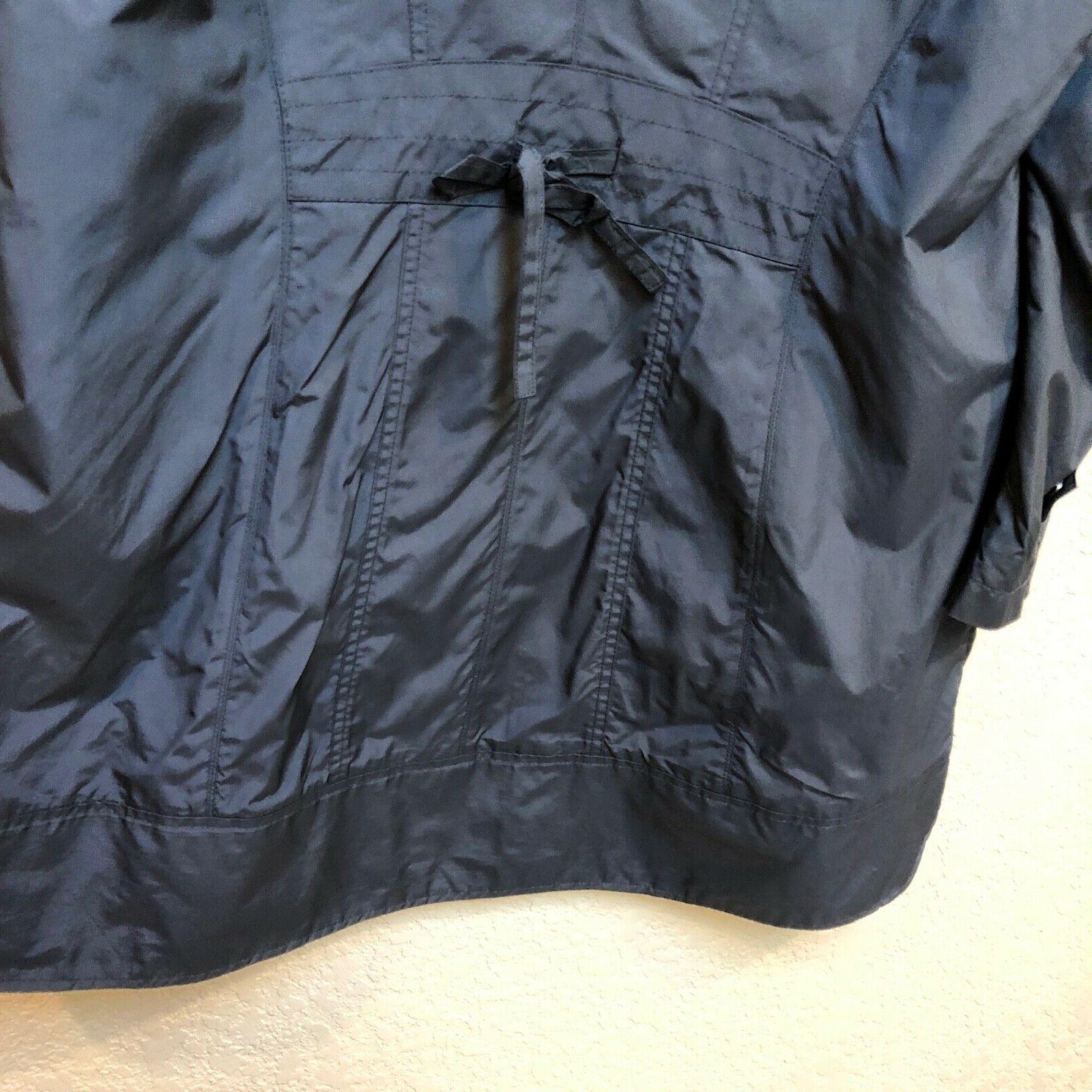 Cole raincoat. Packable. length. Sz woman's